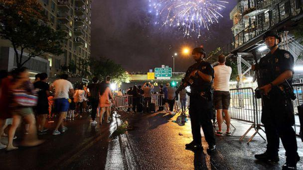 PHOTO: In this file photo from July 4, 2016, counterterrorism police officers watch over spectators for the Fourth of July fireworks along the East River in New York. (Adam Hunger/AP, FILE)