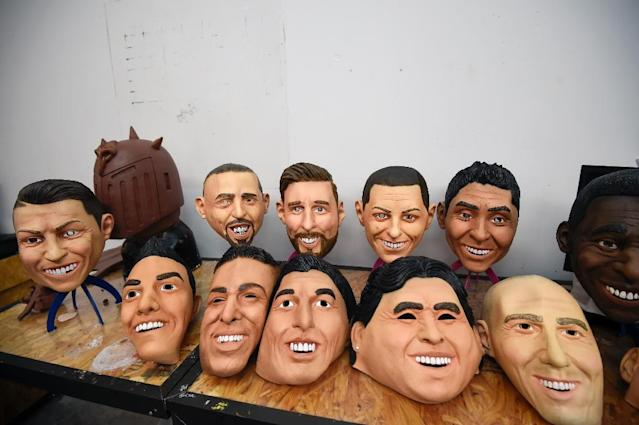 View of latex masks of football players (L to R back to front) Cristiano Ronaldo, Franck Ribery, Lionel Messi, Javier Hernandez, Jorge Campos, Pele, Hirving Lozano, Neymar, Luis Suarez, Diego Armando Maradona, Zinedine Zidane are displayed at a factory in Jiutepec, Morelos State, Mexico (AFP Photo/ALFREDO ESTRELLA)