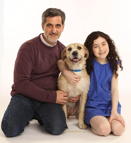 """In this photo provided by Boneau/Bryan-Brown, from left, Tony Award winning animal trainer William Berloni, ëSunny,í who will play the role of Sandy, and Lilla Crawford, who will play the role of Annie, in the new Broadway production of """"Annie."""" Previews begin October 3 and opening night is November 8 at the Palace Theatre. (AP Photo/Boneau/Bryan-Brown, Joan Marcus)"""