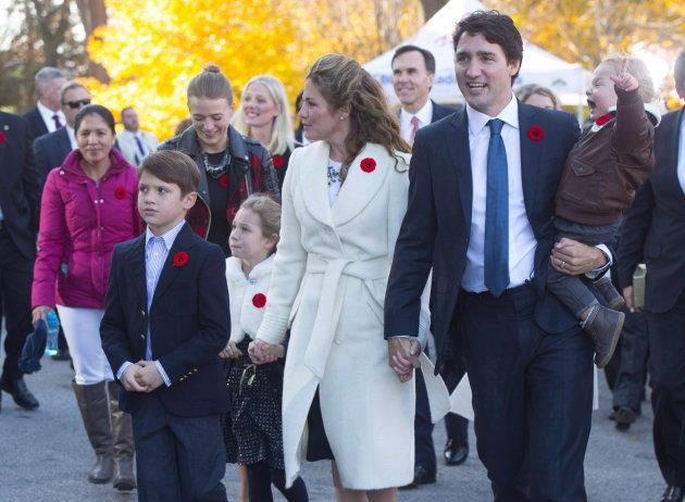 Marylou Trayvilla, one of two women who was employed to take care of the Trudeau children in 2015, is seen at left as she joins prime minister-designate Justin Trudeau and family upon their arrival to Rideau Hall for the swearing-in ceremony in Ottawa. Trayvilla is no longer employed as a caretaker for the Trudeau children.