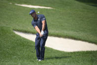 Bryson DeChambeau chips onto the first green during the second round of the BMW Championship golf tournament, Friday, Aug. 27, 2021, at Caves Valley Golf Club in Owings Mills, Md. (AP Photo/Nick Wass)