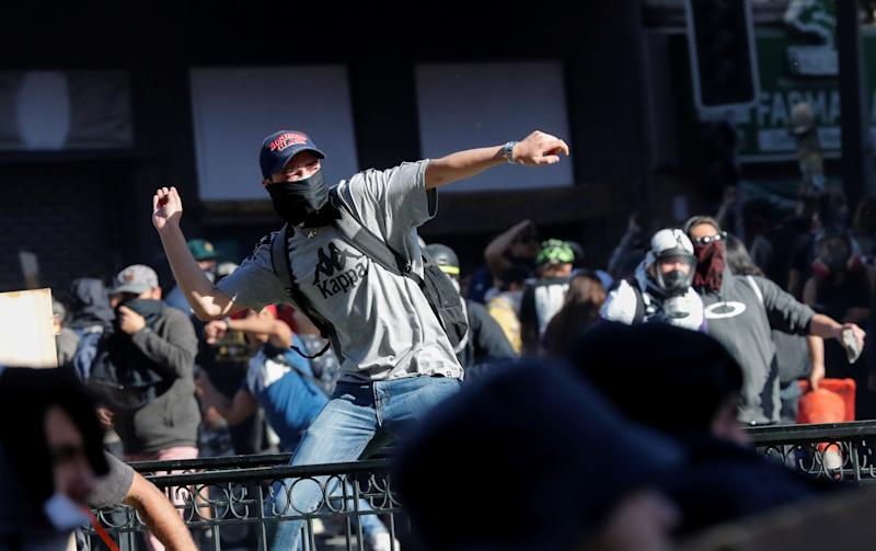 A demonstrator throws a stone during an anti-government protests in Santiago, Chile Oct. 28, 2019. (Photo: Henry Romero/Reuters)