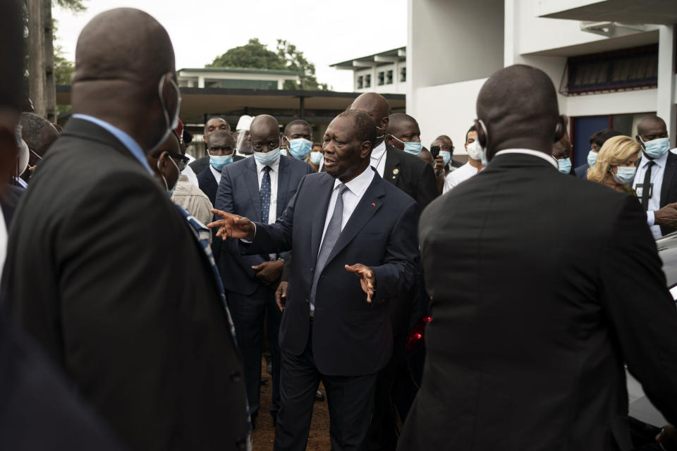 Ivory Coast President Alassane Ouattara leaves after voting in a polling station during presidential elections in Abidjan, Ivory Coast, Saturday, Oct. 31, 2020. Tens of thousands of security forces deployed across Ivory Coast on Saturday as the leading opposition parties boycotted the election, calling President Ouattara's bid for a third term illegal. (AP Photo/Leo Correa)