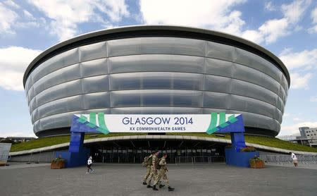 Soldiers walk past the Hydro Arena ahead of the Commonwealth Games in Glasgow