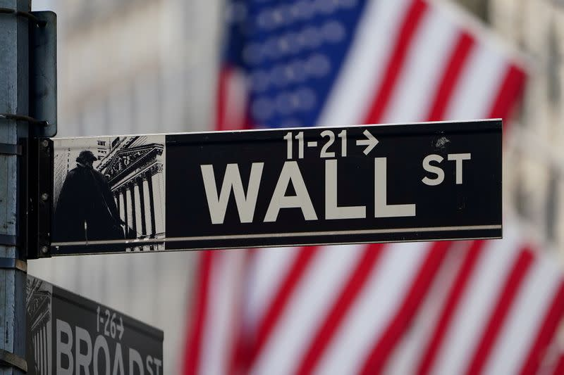 FILE PHOTO: FILE PHOTO: The Wall Street sign is pictured at the New York Stock exchange (NYSE) in the Manhattan borough of New York City