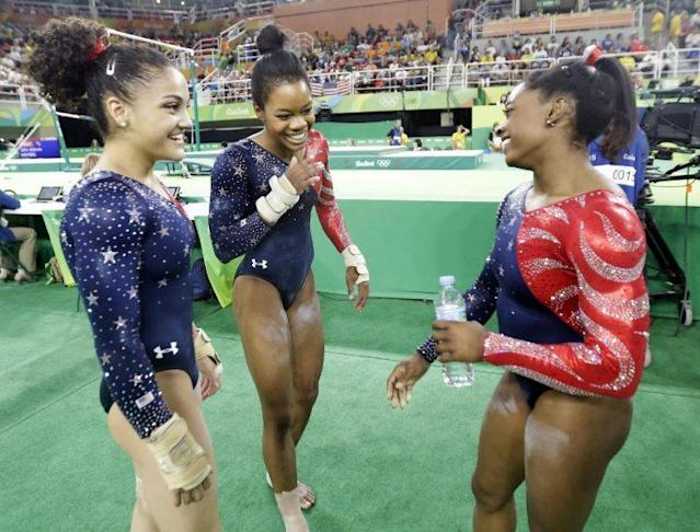 Laurie Hernandez (left), Gabby Douglas and Simone Biles were all smiles on Sunday. (AP)