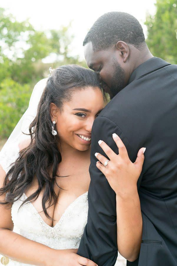 """""""Gabrielle and Derek Holmes Jr. have tied the knot! These two were married at the Rusty Pelican in Tampa, Florida."""" --&nbsp;<i>Ashley Canay</i>"""