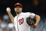 FILE - In this July 25, 2019, file photo, Washington Nationals starting pitcher Max Scherzer throws to the Colorado Rockies during a baseball game in Washington. Three-time Cy Young Award winner Max Scherzer says he is ready to get in a game for the Washington Nationals and come off the injured list. Scherzer played catch at Nationals Park on Wednesday, Aug. 14. a day after throwing the equivalent of about two innings in a simulated game, and said he felt able to return to action from a back muscle problem. (AP Photo/Patrick Semansky, File)