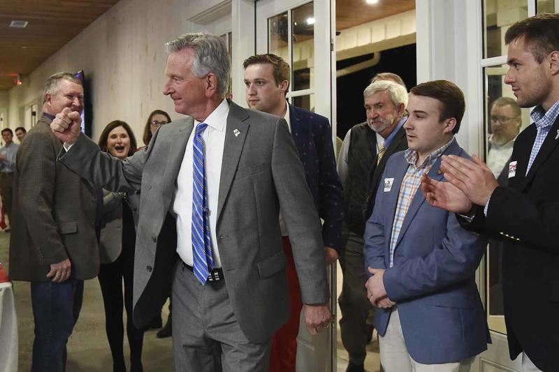 Alabama U.S. Senate candidate Tommy Tuberville pumps his fist toward his supporters at Auburn Oaks Farm in Notasulga, Ala., Monday, March 3, 2020. He is in a close battle with Jeff Sessions and Bradley Byrne. (Joe Songer/AL.com. via AP)