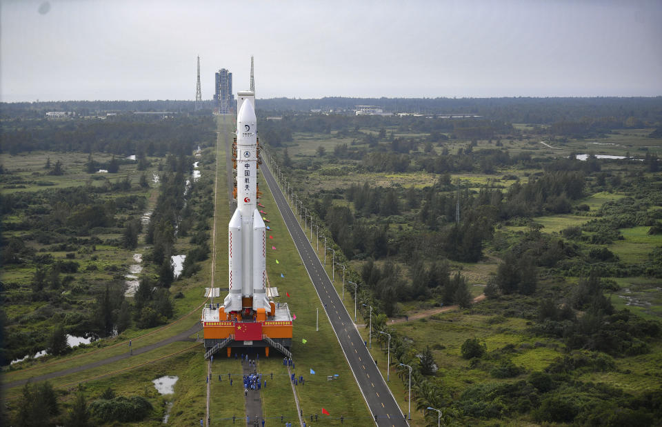 In this Nov. 17, 2020, photo released by China's Xinhua News Agency, a Long March-5 rocket is moved at the Wenchang Space Launch Site in Wenchang in southern China's Hainan Province. Chinese technicians were making final preparations Monday, Nov. 23, 2020, to launch a Long March-5 rocket carrying a mission to bring back material from the lunar surface in a potentially major advance for the country's space program. (Guo Cheng/Xinhua via AP)