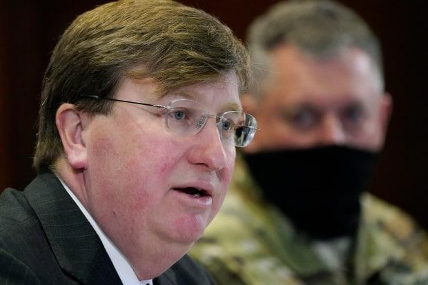 Mississippi Gov. Tate Reeves, seen at a press conference in Jackson, Miss., in January, says he's working to fight vaccine hesitancy and falling demand in his state.