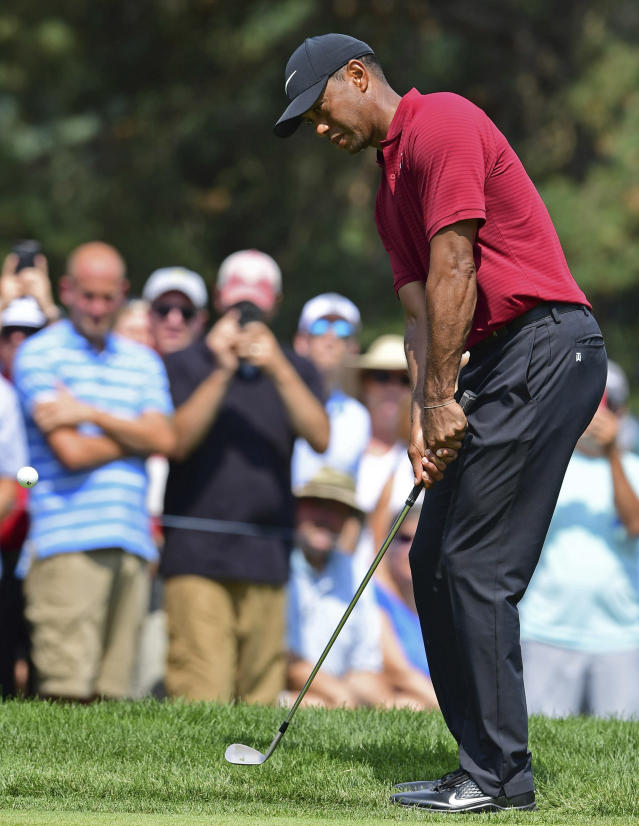 Tiger Woods watches his shot from the rough on the fourth hole during the final round of the Bridgestone Invitational golf tournament at Firestone Country Club, Sunday, Aug. 5, 2018, in Akron, Ohio. (AP Photo/David Dermer)