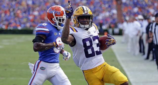 LSU wide receiver Russell Gage crosses the goal line in front of Florida defensive back Nick Washington. (AP)