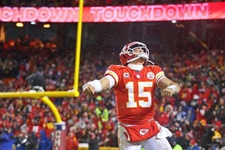 Jan 12, 2019; Kansas City, MO, USA; Kansas City Chiefs quarterback Patrick Mahomes (15) celebrates after a touchdown during the fourth quarter against the Indianapolis Colts in an AFC Divisional playoff football game at Arrowhead Stadium. Mandatory Credit: Mark J. Rebilas-USA TODAY Sports