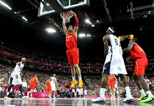 LONDON, ENGLAND - AUGUST 12: Pau Gasol #4 of Spain slam dunks during the Men's Basketball gold medal game between the United States and Spain on Day 16 of the London 2012 Olympics Games at North Greenwich Arena on August 12, 2012 in London, England. (Photo by Christian Petersen/Getty Images)
