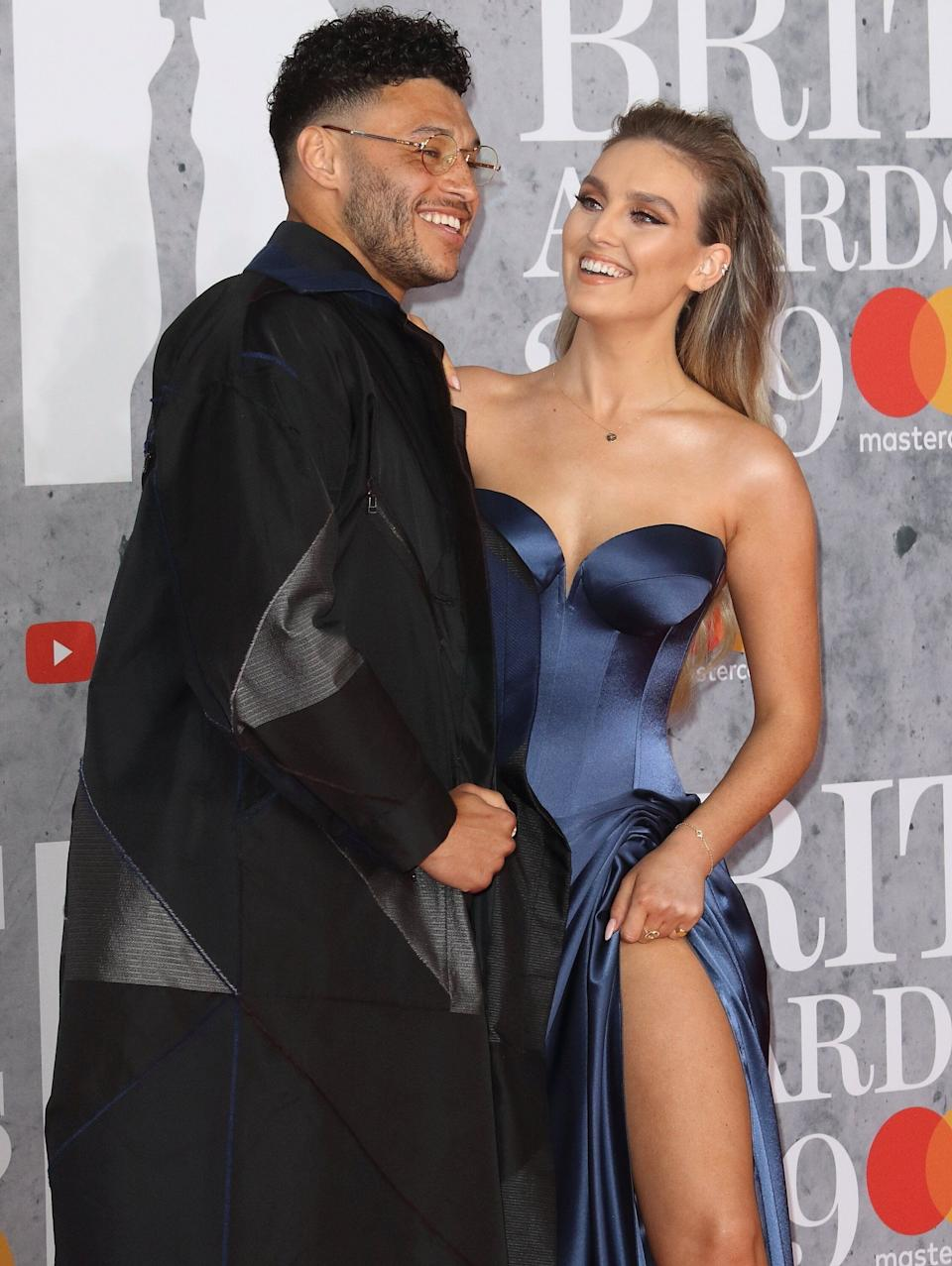 Alex Oxlade-Chamberlain and Perrie Edwards at the Brit Awards in 2019 (Photo: SOPA Images via Getty Images)