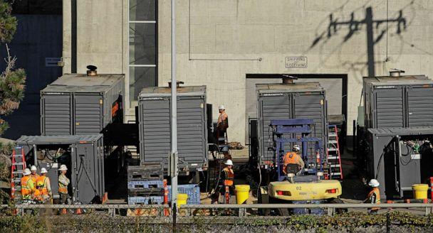 PHOTO:Crews work to connect generators in effort to keep the Caldecott Tunnel open to traffic during a possible power outage, Oct. 9, 2019, in Oakland, Calif. (Ben Margot/AP)