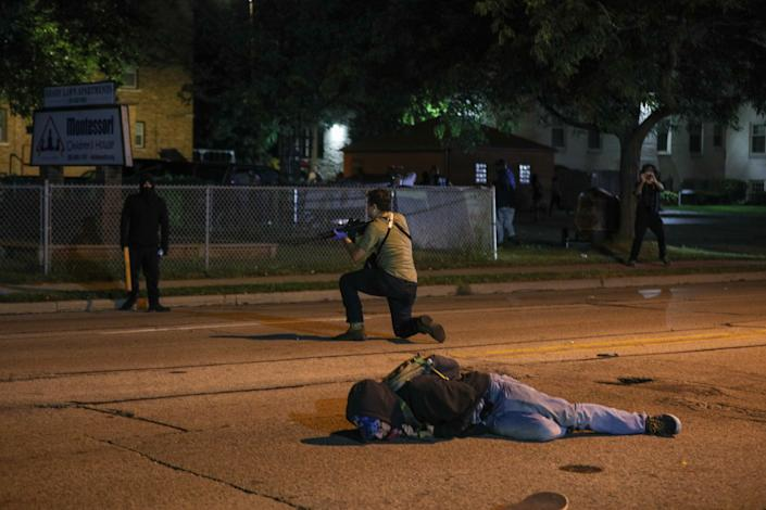 A man on the ground was shot in the chest as clashes between protesters and armed civilians who protect the streets of Kenosha against the arson during the third day of protests over the shooting of a black man Jacob Blake by police officer in Wisconsin, United States on August 25, 2020. (Tayfun Coskun/Anadolu Agency via Getty Images)