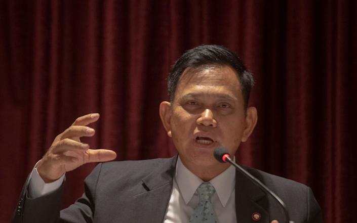 A spokesperson for the Office of the Attorney General announces a er-examination of the evidence in the case - Sakchai Lalit/AP