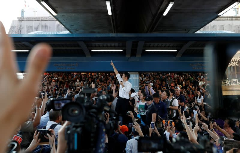 Thanathorn of Thailand's progressive Future Forward Party gestures to his supporters at a sudden unauthorised rally in Bangkok
