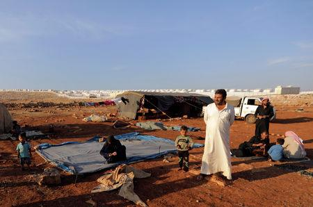 Newly displaced Syrians arrive to a refugee camp in Atimah village Idlib province Syria