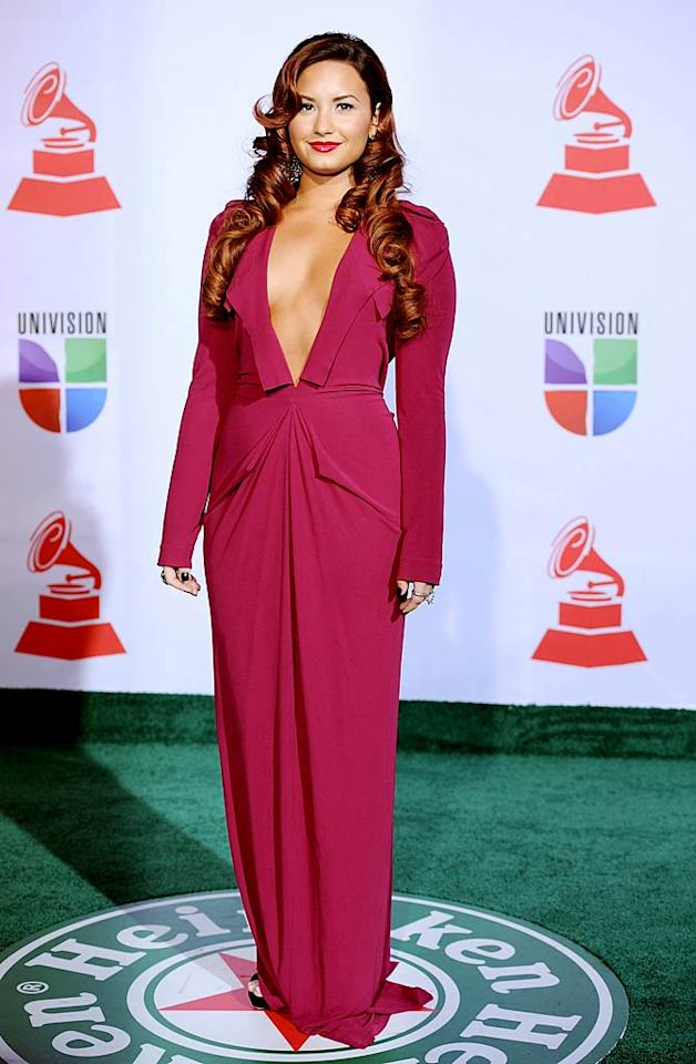 Demi Lovato delivered a fashion faux pas upon arriving at the 12th Annual Latin Grammy Awards on Thursday evening. The former Disney darling made the mistake of donning her baggy, raspberry-hued Roland Mouret dress backwards, with the frock's daring plunge in front. As a result, the intended silhouette suffered, along with our eyes. Overly curled hair extensions and black nail polish only added to her style misstep. (11/10/2011)