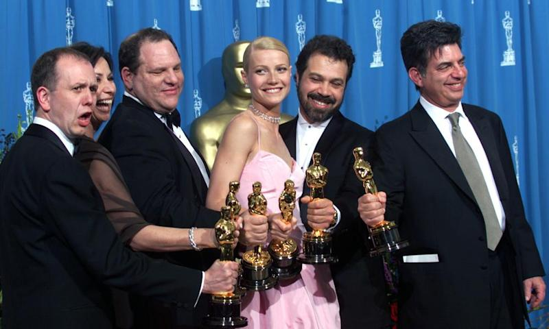 Gwyneth Paltrow with Harvey Weinstein and others after Shakespeare in Love swept the 1999 Oscars.