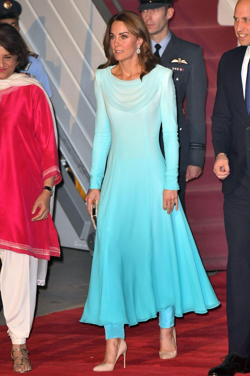 <p>Upon arrival in Pakistan, Kate wore a bespoke Catherine Walker look.</p>