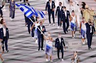 <p>While the men's uniforms were pretty basic, the women in Greek's delegation wore super-chic pleated skirts. </p>