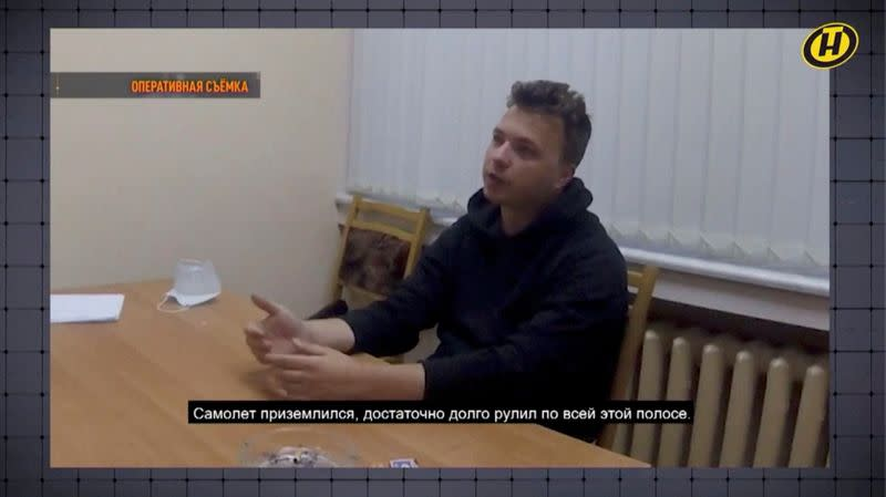 Belarusian dissident journalist Roman Protasevich speaks during questioning in an unknown location