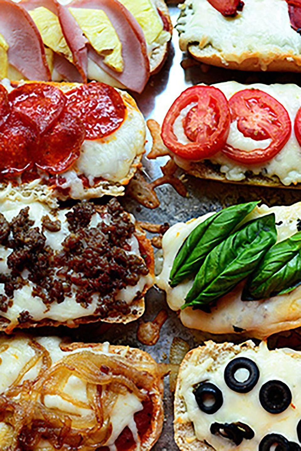 """<p>The whole family can be involved in adding their favorite toppings to slices of French bread in this quick pizza recipe.</p><p><strong>Get the recipe at <a href=""""http://thepioneerwoman.com/cooking/french-bread-pizzas/"""" rel=""""nofollow noopener"""" target=""""_blank"""" data-ylk=""""slk:The Pioneer Woman"""" class=""""link rapid-noclick-resp"""">The Pioneer Woman</a>.</strong><br></p>"""