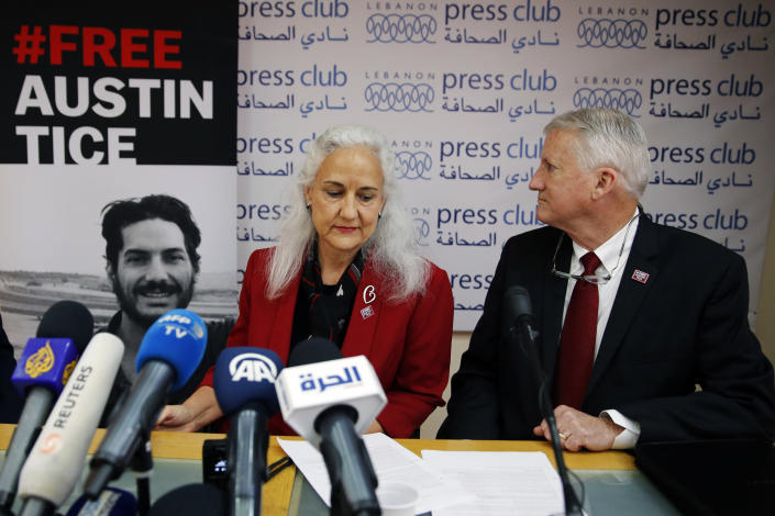 FILE - In this Dec. 4, 2018, file photo Marc and Debra Tice, the parents of Austin Tice, who is missing in Syria, speak during a press conference, at the Press Club, in Beirut, Lebanon. Talks between U.S. and Syrian officials last summer over the fate of Austin Tice and other American hostages foundered over conditions laid out by Damascus and because of a lack of meaningful information provided on the fate of Tice. That's according to people who spoke to The Associated Press in recent weeks about the secretive talks last August. (AP Photo/Bilal Hussein, File)