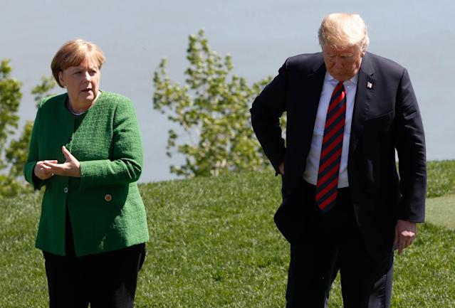 <p>Germany's Chancellor Angela Merkel talks with President Donald Trump at a family photo session with the leaders of the G-7 summit in Charlevoix, Quebec, Canada, June 8, 2018. (Photo: Yves Herman/Reuters) </p>