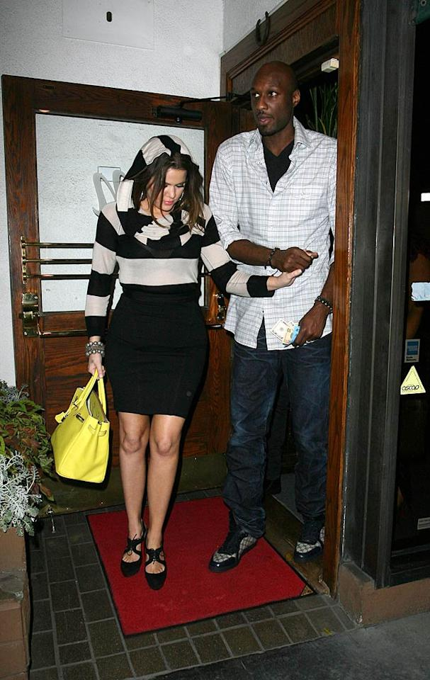 """Two days after her sister Kim's big wedding, Khloe Kardashian and her hubby were snapped exiting Madeo, an Italian eatery in West Hollywood, California. """"Getting ready for date night,"""" Khloe tweeted before heading out with her main squeeze to meet Eva Longoria and her beau Eduardo Cruz for a double date! Roshan Perera/<a href=""""http://www.splashnewsonline.com/"""" target=""""new"""">Splash News</a> - August 22, 2011"""