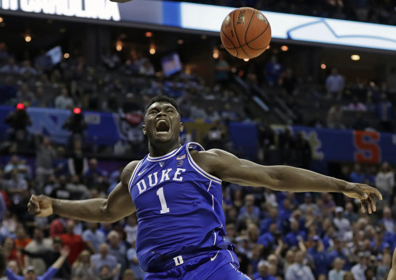 FILE - In this March 15, 2019, file photo, Duke's Zion Williamson (1) reacts after a dunk against North Carolina during the second half of an NCAA college basketball game in the Atlantic Coast Conference tournament, in Charlotte, N.C. Williamson was selected to The Associated Press All-America first team, Tuesday, April 2, 2019. (AP Photo/Nell Redmond, File)