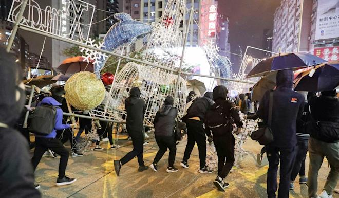 Protesters use Christmas decorations for a roadblock on Nathan Road near Mong Kok Police Station. Photo: Edmond So