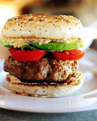 """<p>Yes, this turkey burger is sandwiched on a bagel. Egg yolk is the binder in this easy recipe.</p><p><strong><a href=""""https://thepioneerwoman.com/cooking/turkey-bagel-burger/"""" rel=""""nofollow noopener"""" target=""""_blank"""" data-ylk=""""slk:Get the recipe."""" class=""""link rapid-noclick-resp"""">Get the recipe.</a></strong></p><p><strong><a class=""""link rapid-noclick-resp"""" href=""""https://go.redirectingat.com?id=74968X1596630&url=https%3A%2F%2Fwww.walmart.com%2Fip%2FThe-Pioneer-Woman-Frontier-Rose-2-Piece-Stainless-Steel-Cutlery-Set%2F271652005&sref=https%3A%2F%2Fwww.thepioneerwoman.com%2Ffood-cooking%2Fmeals-menus%2Fg32188535%2Fbest-grilling-recipes%2F"""" rel=""""nofollow noopener"""" target=""""_blank"""" data-ylk=""""slk:SHOP KNIVES"""">SHOP KNIVES</a></strong></p>"""