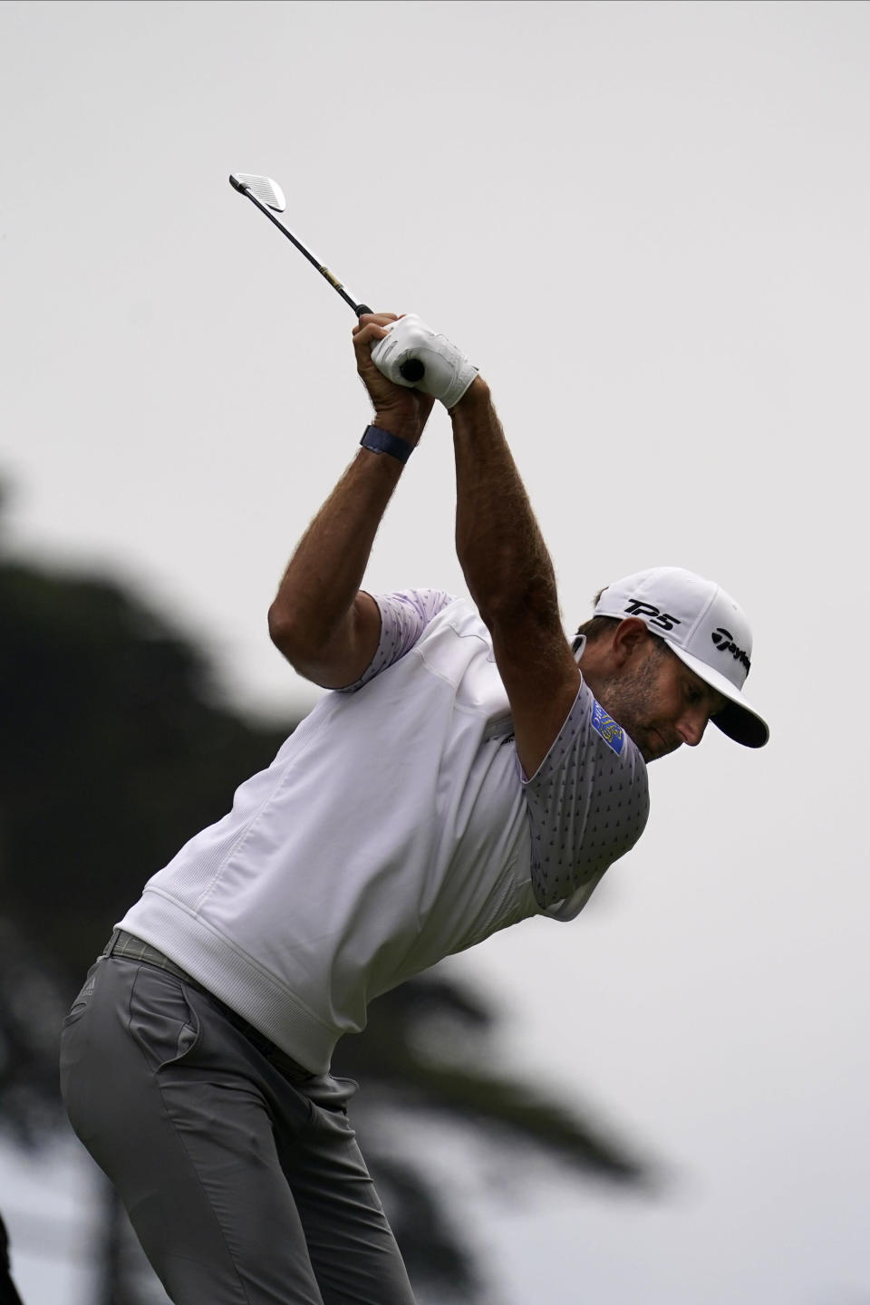 Dustin Johnson hits his tee shot on the second hole during the third round of the PGA Championship golf tournament at TPC Harding Park Saturday, Aug. 8, 2020, in San Francisco. (AP Photo/Jeff Chiu)