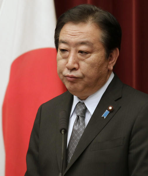 Japan's Prime Minister Yoshihiko Noda listens to a reporter's question during a press conference at his official residence in Tokyo, Friday, March 30, 2012. Prime Minister Noda vowed to stake his political career to achieve the sales tax increase Friday as his Cabinet endorsed a legislation to help counter the country's fiscal deficit. (AP Photo/Shizuo Kambayashi)