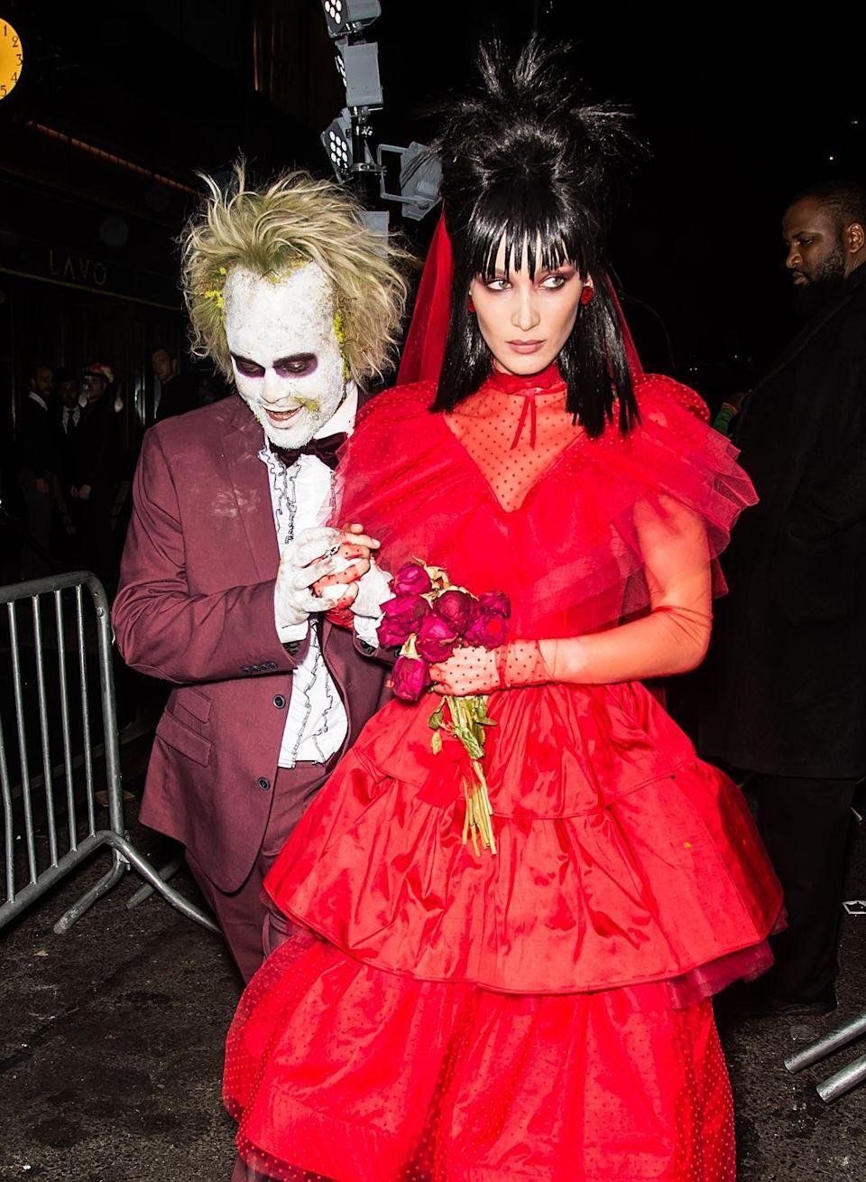 <p>Singer The Weekend and model Bella Hadid strutted into Heidi Klum's 2018 Halloween shindig as characters from Tim Burton's 1988 movie <em>Beetlejuice</em>. The Weeknd went all-out as Beetlejuice himself, and Bella pulled off Winona Ryder's Lydia Deetz in a perfect red dress.</p>