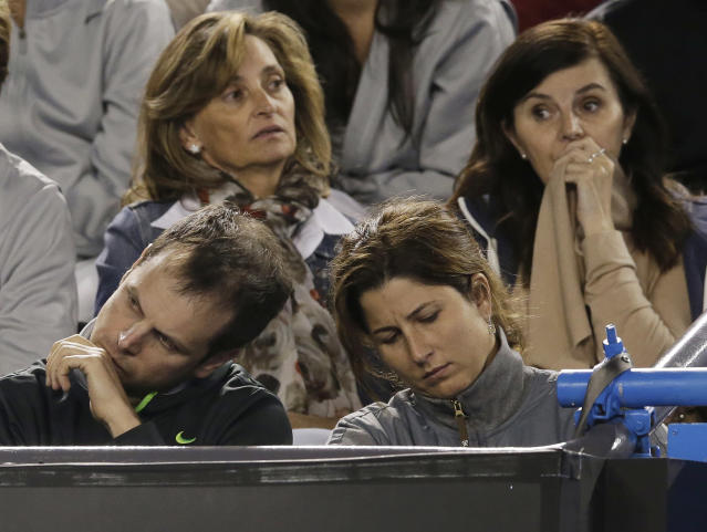 Mirka Federer reacts during the final set in the semifinal match between her husband Roger Federer and Britain's Andy Murray at the Australian Open tennis championship in Melbourne, Australia, Friday, Jan. 25, 2013. (AP Photo/Andy Wong)