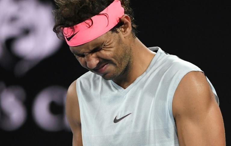 Spain's Rafael Nadal grimaces after injuring his leg in his Australian Open quarter-final match against Marin Cilic