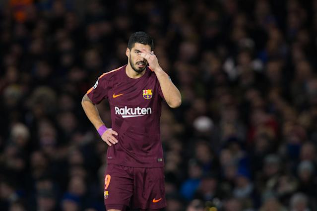 Luis Suarez reacts during the UEFA Champions League Round of 16 First Leg match between Chelsea FC and FC Barcelona