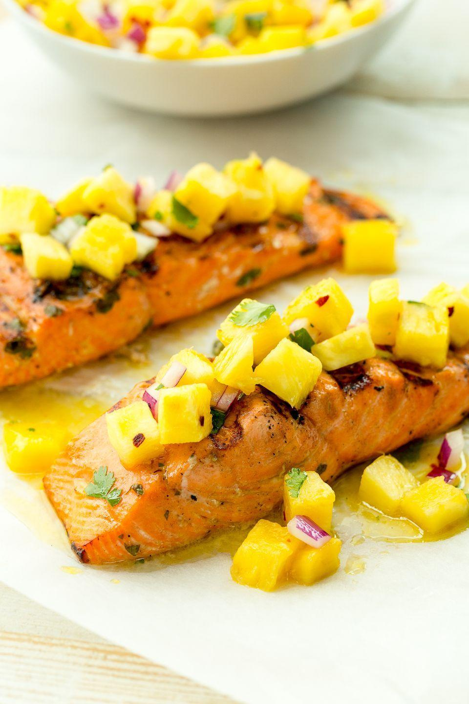 "<p>Fruity salsa is our new favorite condiment for grilled fish.</p><p>Get the recipe from <a href=""https://www.delish.com/cooking/recipe-ideas/recipes/a47376/grilled-salmon-with-pineapple-salsa-recipe/"" rel=""nofollow noopener"" target=""_blank"" data-ylk=""slk:Delish"" class=""link rapid-noclick-resp"">Delish</a>.</p>"