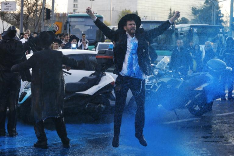 This file picture from March 20, 2017 shows Israeli police spraying water at ultra-Orthodox Jews during a protest against army conscription