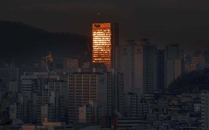 The cluster of cases has alarmed official in Seoul - EPA
