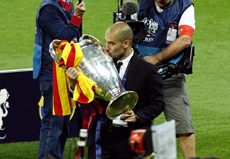 Barcelona's manager Josep Guardiola kisses the champions league trophy (Photo by Sean Dempsey/PA Images via Getty Images)