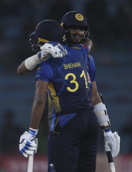 Sri Lankan batsman Dasun Shanaka, right, celebrates his fifty with Shehan Jayasuriya during the second one-day international in Karachi, Pakistan, Monday, Sept. 30, 2019. Pakistan marked return of ODI cricket in Karachi after 10 years with a 67-run victory over Sri Lanka in the second one-day international of the three-match series on Monday. (AP Photo/Fareed Khan)