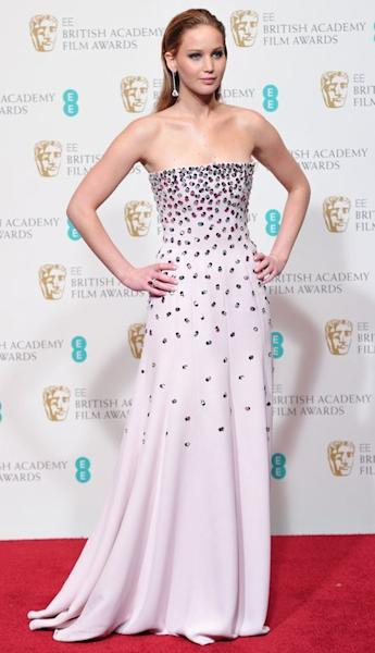 "Actress Jennifer Lawrence at the BAFTA Awards at the Royal Opera House in London on February 10, 2013. Lawrence, nominated for the best actress Oscar again this year, was first tapped in 2010 at age 20 for ""Winter's Bone"""