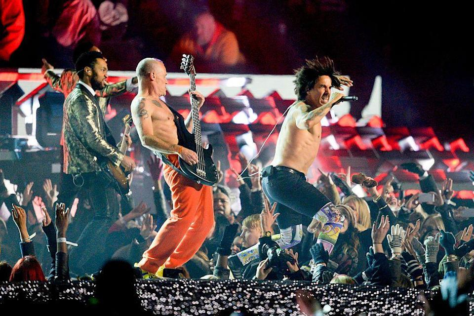 <p>Both lead singer Anthony Kiedis and bassist Flea decided to go shirtless. </p>